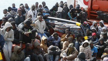 Rescued migrants arrive at the Sicilian harbour of Pozzallo on Sunday.