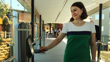 Directing commuters: Transport Minister Gladys Berejiklian trials the Opal Card.