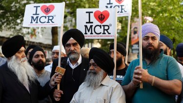 Members of the Manchester Sikh community attend a vigil in Albert Square, Manchester on Tuesday afternoon.