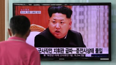 A man looks at a television screen showing an image of Kim Jong Un, leader of North Korea: The country's geopolitical volatility was on full display again last week