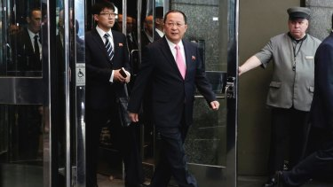 North Korean Foreign Minister Ri Yong-ho, followed by his interpreter, walks to the microphones in New York on Monday to say Donald Trump's remarks amounted to a declaration of war against his country.