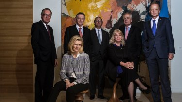 Senior investment bankers and corporate leaders (from left): David Gonski, Catherine Brenner, Steven Skala, Peter Mason, Audette Exel, Diccon Loxton and Peter Hunt posing to promote the pro bono initiative.