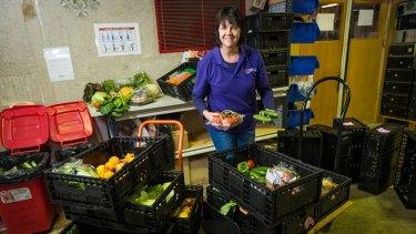 HandUp manager Sandra MacDonald sorts produce to go on to shelves.