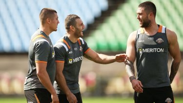 Still able to laugh: Robbie Farah shares a joke with teammates at Wests Tigers training.