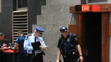 Police at the scene of the fatal shooting during filming of the Bliss n Eso music video in Brisbane's Eagle Lane.
