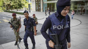 Malaysian military and police patrol  outside a shopping mall in Kuala Lumpur.