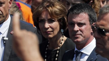 People boo French prime minister Manuel Valls, center, and Health Minister Marisol Touraine, after a minute of silence in NIce.