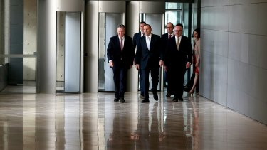 ASIO director-general of security Duncan Lewis, Justice Minister Michael Keenan, Prime Minister Tony Abbott, Immigration Minister Peter Dutton and Attorney-General Senator George Brandis during their visit to the ASIO headquarters in Canberra.
