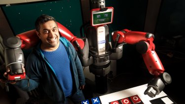 University of Canberra researcher Damith Herath with his robot Baxter, who has been taught to cheat at tic tac toe.