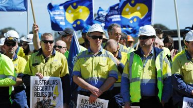 Workers from ASC listen to speakers outside the ship building headquarters in Adelaide.