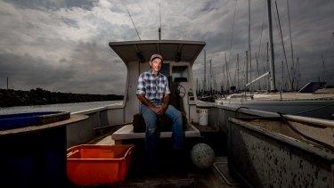 Commercial fishermen Dugga Beazley on his boat at St Kilda.