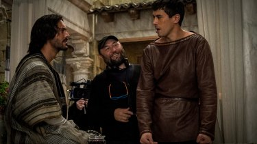 No mere remake: Huston as Ben-Hur, film director Timur Bekmambetov and Toby Kebbell as Messala Severus.