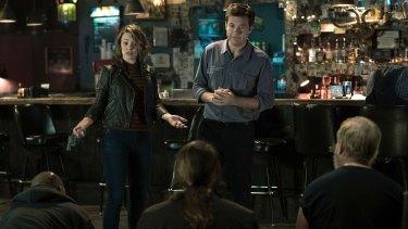Rachel McAdams, left, and Jason Bateman in Game Night.