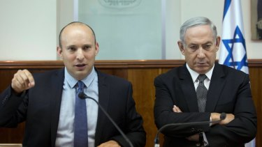 Rivals and partners: Israeli Prime Minister Benjamin Netanyahu, right, and Israeli Education Minister Naftali Bennett of the far-right Jewish Home party.