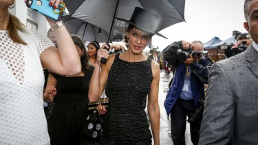 Hilary Swank dodging a shower at Derby Day.