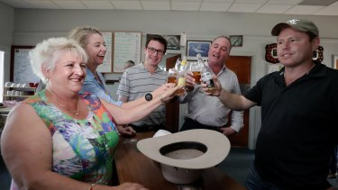Mr Joyce has a beer while meeting with Nationals colleagues Michelle Landry, Bridget McKenzie, David Littleproud and Andrew Broad at the Aero Club at the Tamworth Airport on Friday.