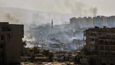 Smoke rises in east Aleppo.