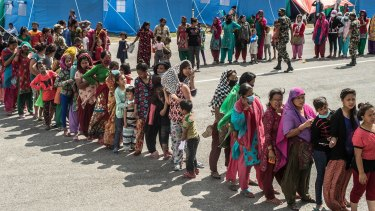 """""""So the last shall be first and the first last."""" Earthquake victims queue for aid in Nepal this year."""