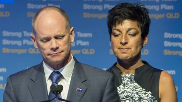 Campbell Newman speaks to LNP supporters, flanked by his wife Lisa.