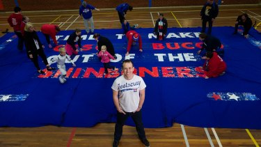 Bit of a laugh: Comedian Danny McGinlay is spicing up the banners for the Bulldogs.