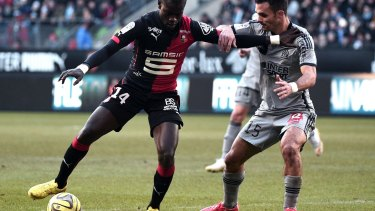 In control: Rennes' Fallou Diagne vies with Marseille's Jeremy Morel.