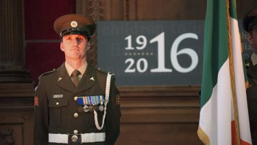 An Irish soldier stands guard in Dublin where the city is preparing for the centenary of the 1916 Easter Rising.