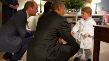 Prince George shakes hands with President Obama at Kensington Palace.