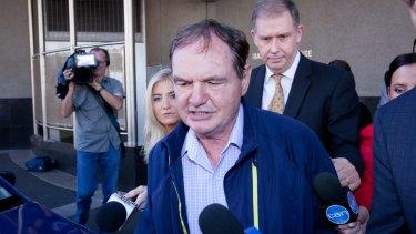 Ex-Ipswich mayor Paul Pisasale leaves court.