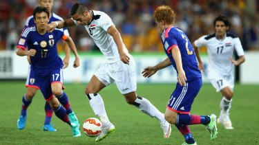 Dynamic: Ali Adnan Kadhim of Iraq takes on the Japanese defence in Brisbane.