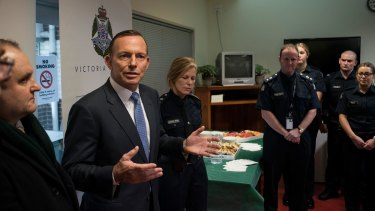 Former prime minister Tony Abbott discusses counter terrorism with Victoria Police and the AFP at Endeavour Hills Police Station in Melbourne in June.