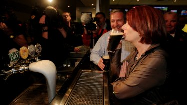Julia Gillard sips a Tooheys Old during the 2010 campaign.
