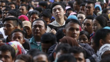 Sluggish economy: young Indonesians  at a jobs fair in Jakarta this week.