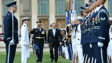 Prime Minister Tony Abbott received full military honours during his visit to the US Pentagon a year ago.