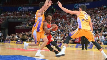 Break and enter: United's Casper Ware tries to find an opening in the Kings' defence.