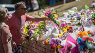 A couple pay their respects at Dreamworld on Thursday.