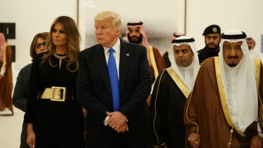 President Donald Trump and first lady Melania Trump visit an art exhibit with Saudi King Salman at the Royal Court Palace.