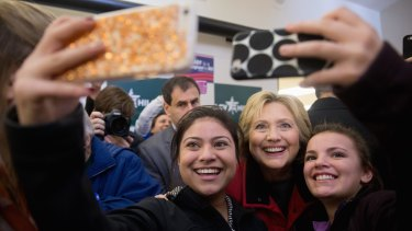 Democratic presidential candidate Hillary Clinton taking photos with workers at her campaign office in Des Moines, Iowa.