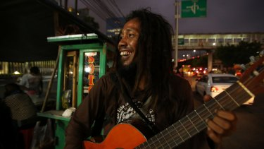 Bambang 'Ho' Mulyono performs on the streets of Jakarta. He is one of three buskers who feature in the documentary <i>Jalanan</i> by Daniel Ziv.