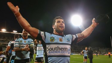 Railing the Raiders: Michael Ennis mimics the Canberra fans' Viking clap last year.