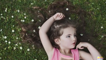 """Mela features in the photographic art book called """"The Super Power Baby Project""""."""