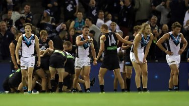Highs and lows: Blues and Port players had different reactions on the final siren.