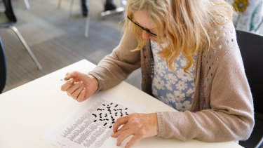 Maree, like many regulars at Uniting's early morning centre, enjoys solving a crossword with breakfast.