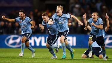 Sydney FC players celebrate after Milos Ninkovic kicked the winning goal in the shoot-out.