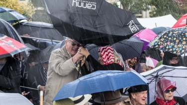 People caught in torrential rain on Sunday.