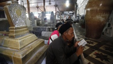 Worshippers pray at the shrines in the hope that the Wali Songo will intercede with God on their behalf.