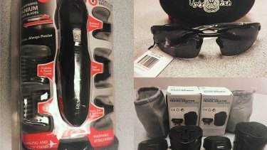 A men's shaver, sunglasses and international power adapters found in Fatima Elomar's luggage.