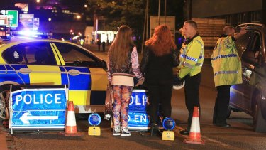 Police at Manchester Arena after reports of an explosion.