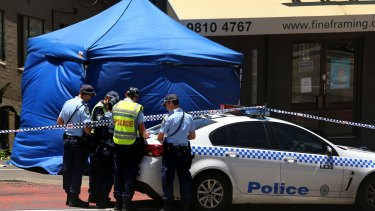 A crime scene tent erected at the crash scene on Victoria Road in Rozelle on Sunday.