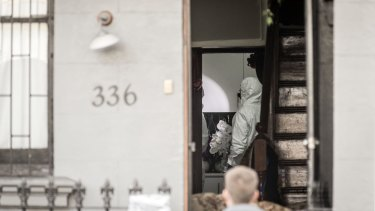 Forensic officers search a property in Surry Hills on Sunday.