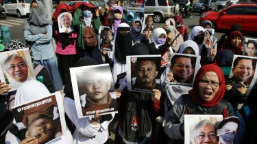 Muslim women hold posters of Wirathu, the leader of Myanmar's nationalist Buddhist monks, Myanmar's State Counsellor Aung San Suu Kyi, President Htin Kyaw, and Chief Senior Military General Min Aung Hlaing.